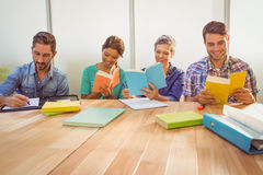 Group of colleagues reading books Stock Photo