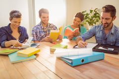Group of colleagues reading books Stock Images
