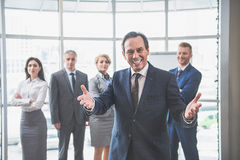 Group of colleagues is standing at office Stock Photography