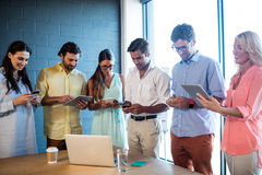 Group of colleagues using tablet computer Stock Photography