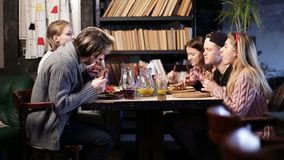 Group of college friends eating lunch together stock footage
