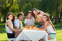 Group of college friends posing for the camera Stock Images