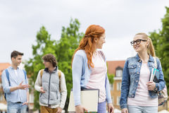 Group of college friends walking outdoors Royalty Free Stock Photos