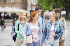 Group of college friends walking outdoors Royalty Free Stock Photo