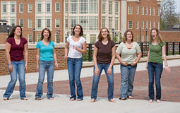 Group of College Girls. Jumping Royalty Free Stock Image
