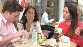 Group Of College Students Eating Lunch Together stock video footage