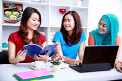 Group of college students enjoy studying together Royalty Free Stock Photos