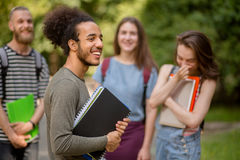 Group of college students latinamerican boy on foreground. Royalty Free Stock Photos