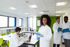 Group Of College Students In Science Class With Experiment Royalty Free Stock Image