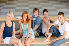 Group of college students sitting looking camera. Group of college student friends sitting on bench looking camera Royalty Free Stock Image
