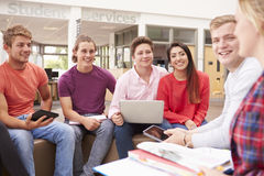 Group Of College Students Sitting And Talking Together Stock Image