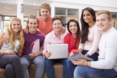 Group Of College Students Sitting And Talking Together Royalty Free Stock Photography