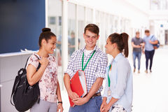 Group Of College Students Standing In Corridor Stock Photos