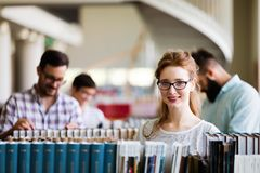 Group of college students studying at library Royalty Free Stock Photography