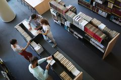Group of college students studying at library Stock Photos