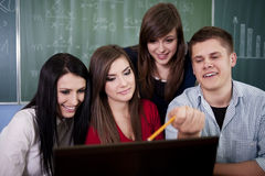 Group of college students using laptop Royalty Free Stock Photography
