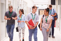 Group Of College Students Walking Along Corridor Stock Images