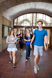 Group of college students. Walking through hall Royalty Free Stock Image