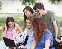 Group of college/university students with laptop Royalty Free Stock Images