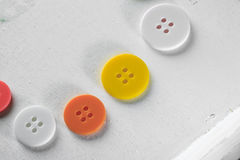 Group of color buttons in a white box stock photo