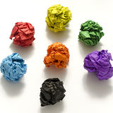 Group of color crumpled paper ball. On a white background Stock Image