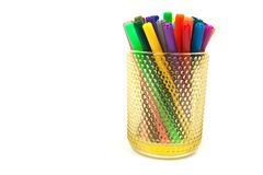 Group of color felt-tipped pens in a glass, white background.  stock image