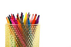 Group of color felt-tipped pens in a glass, white background Royalty Free Stock Photo