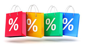 Group of color paper shopping bags with percent symbols Royalty Free Stock Photos