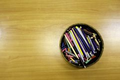 Group of color pencil and marker in basket on table royalty free stock image