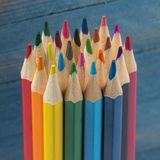 Group of color pencils on blue background. Group of color pencils on blue wooden background stock photo