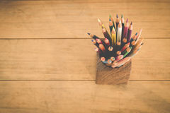 Group of color pencils in a wood cup . Royalty Free Stock Photo