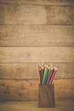 Group of color pencils in a wood cup . Royalty Free Stock Photos
