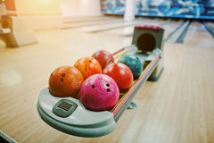 A group of colored bowling balls at bowl lift. Stock Photos
