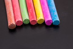 Group of colored chalk to draw. On black Royalty Free Stock Images
