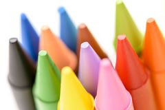 Group of colored crayons on white background. Detail Royalty Free Stock Photos