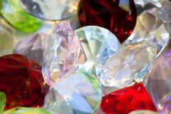 Group of colored diamons of different sizes . Royalty Free Stock Photography