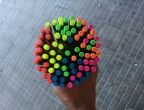 Colored felt-tip pens in hand. Group of colored felt-tip pens royalty free stock photos