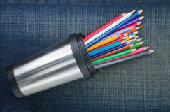 Group of colored pencils in cup with metal. Royalty Free Stock Photography