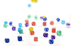 Group of colored plastic dice falling Royalty Free Stock Images