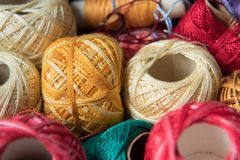 Group of colored sewing threads as colorful background or wallpaper. Stock Photos