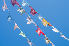 A group of colored shirts on a clothesline Stock Image