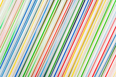 Group of colored straw. As a background Stock Photos