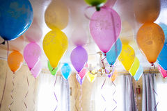 Group of colorful balloons on white ceiling Stock Image
