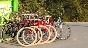 Group of colorful bicycles parked together in a parking lot closeup royalty free stock photo