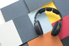 Group of colorful books and headphones related to audiobooks Stock Images
