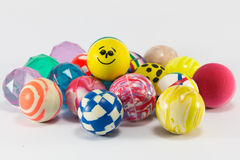 Group of colorful bouncing balls toy. Group of colorful bouncing rubber balls over white background royalty free stock photo