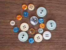 Group of colorful buttons on the wooden table Royalty Free Stock Images