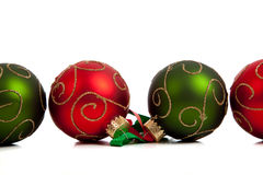 A group of colorful Christmas Baubles on White Royalty Free Stock Photo