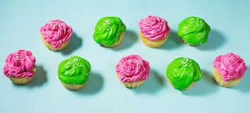 Group of colorful cupcake on blue. Background royalty free stock images