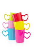 Group of colorful cups, on white. Group of colorful cups with heart element, on white background Stock Photo
